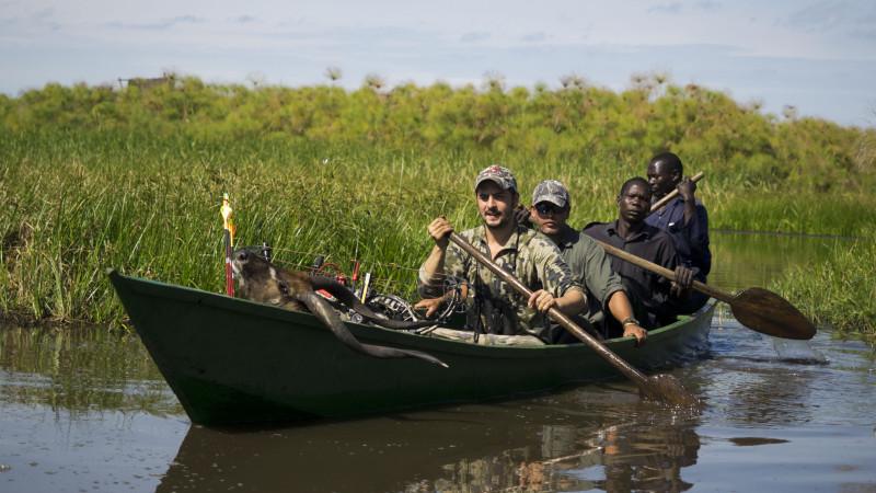 Pedro dAmpuero in the canoe with locals